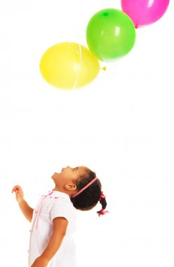 Pretty little girl playing with balloons