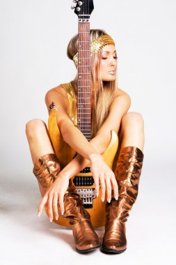 Golden girl with electric guitar