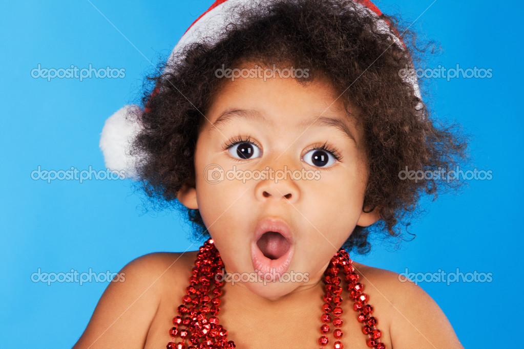 Surprised little child in Christmas hat