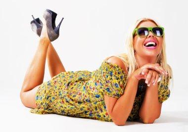 Beautiful cheerful blonde in green sunglasses