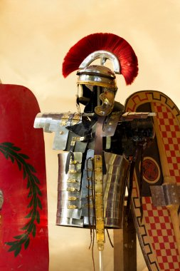 Roman armour in front of some shields stock vector