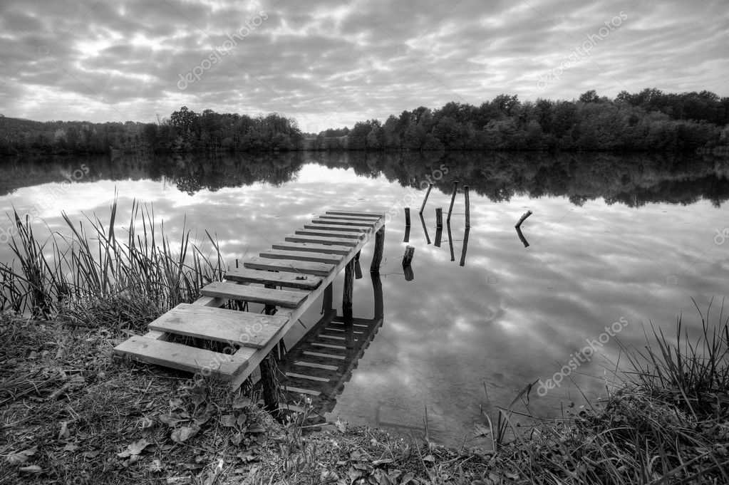 Landspace photo of still lake in black and white
