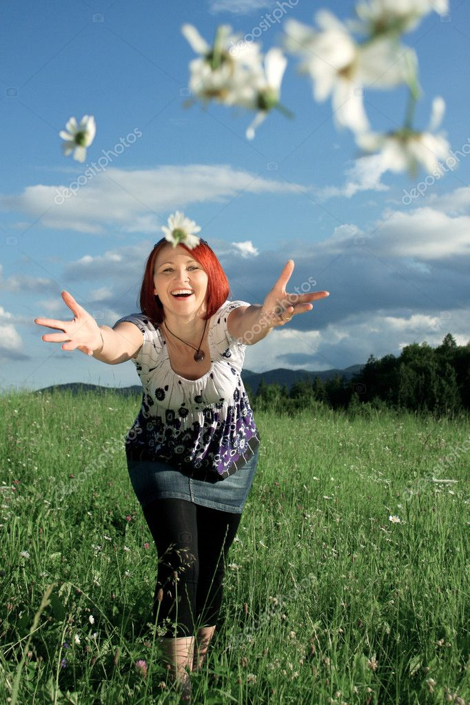 Woman throwing daisies