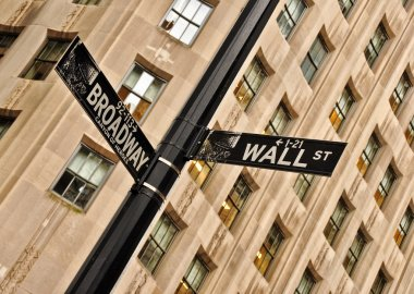 Wall street and Broadway street sign