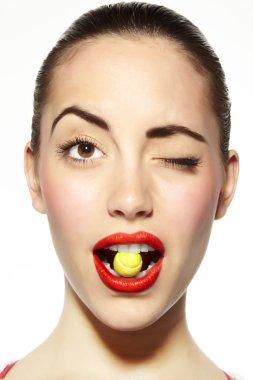 Mouth bitting sugar tennis ball