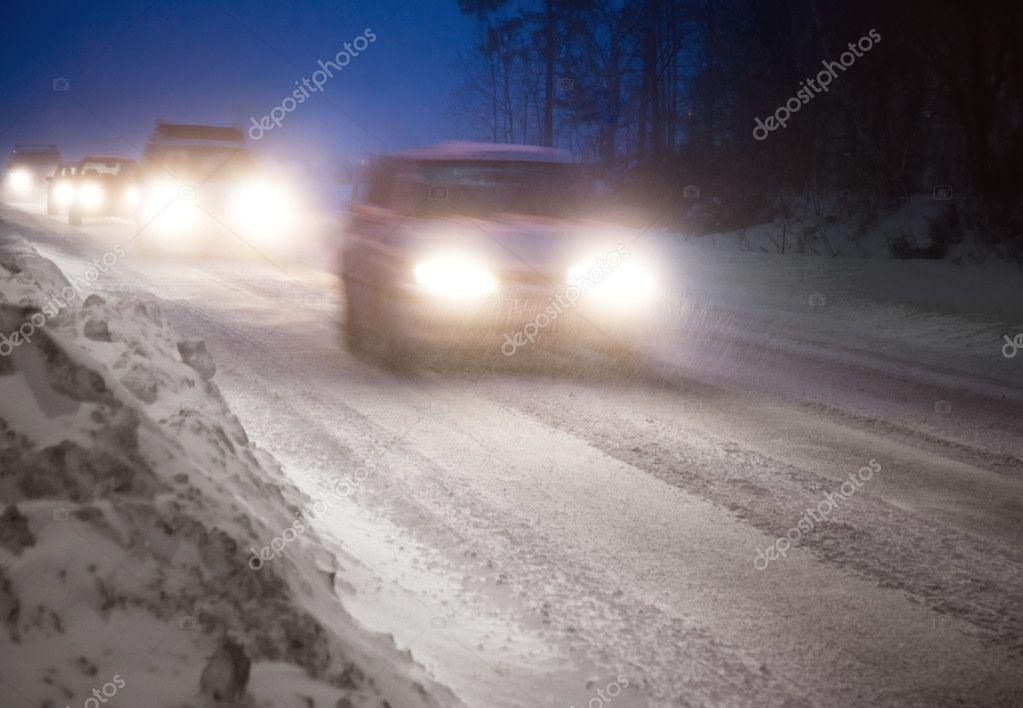 Traffic in winter evening