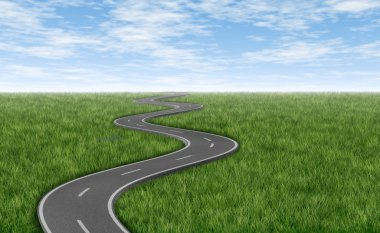 Winding road on green grass horizon