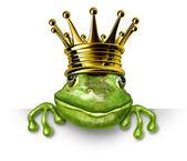 Fotografia principe ranocchio con corona in oro con un cartello bianco
