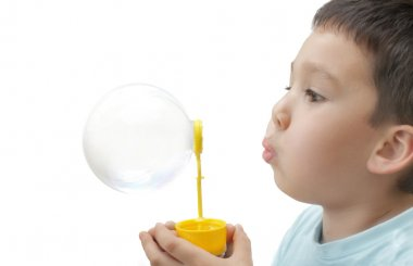 Child plays with bubbles