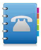 Fotografia spirale di rubrica telefonica blu con etichette a colori