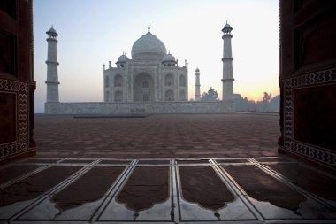 Sunrise Taj Mahal seen through an entrance