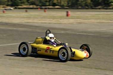 Vintage Yellow Race Car