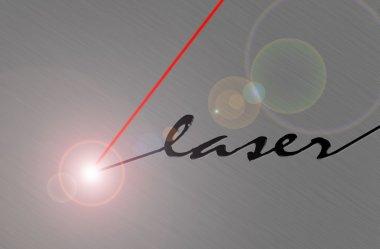 Laser beam cuts brushed metal