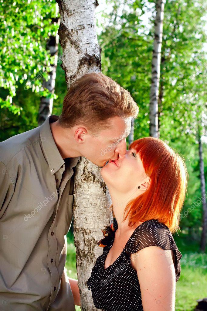 Women and men kisses outdoor