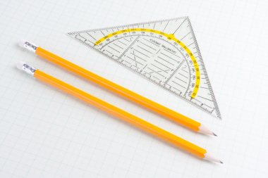 Mathematics ruler and pencils on squared paper