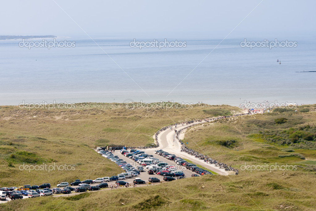 Aerial view of a Dutch beach with dunes and a parking area in fr