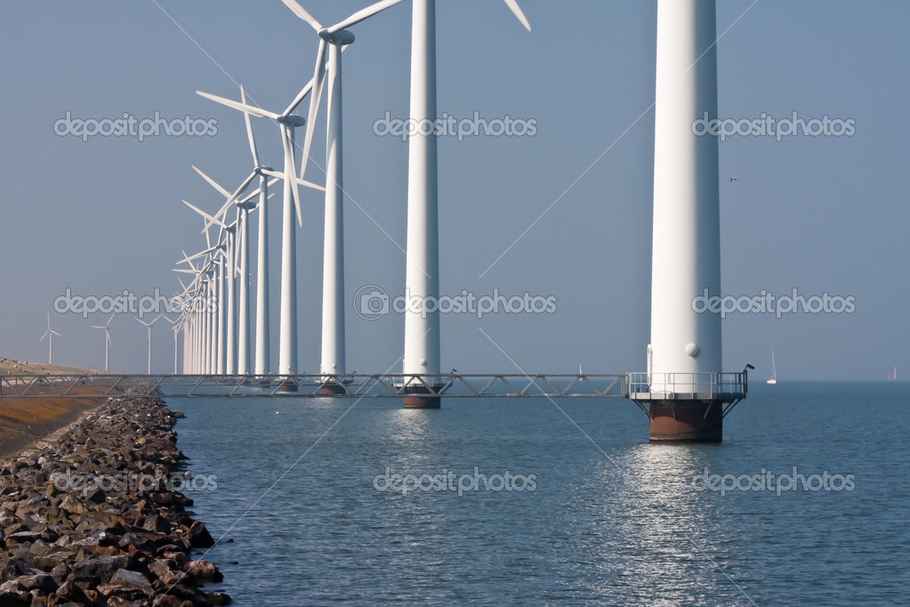 Row of windmills standing in Dutch sea