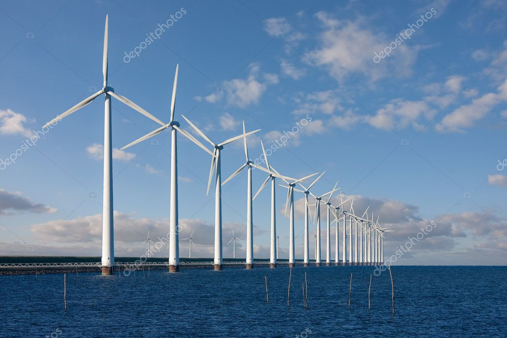 Enormous windmills standing in the sea