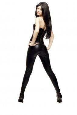 Àmazing girl in black leather pants and corset