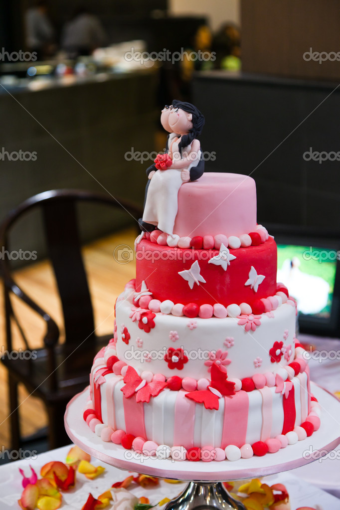 Red pink and white wedding cake stock photo frozensage 7536442 a 4 tier pink red and white shaded wedding cake with figurines of the couple sitting at the top holding flowers photo by frozensage junglespirit Image collections