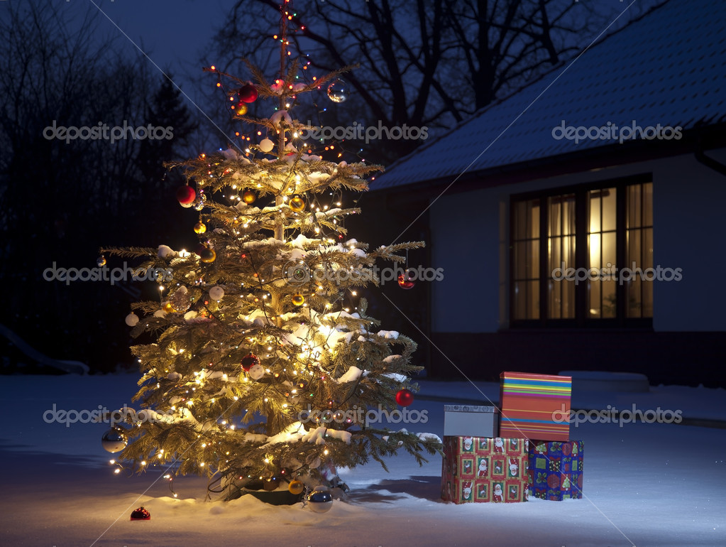 Christmas Tree with home outside with gift boxes