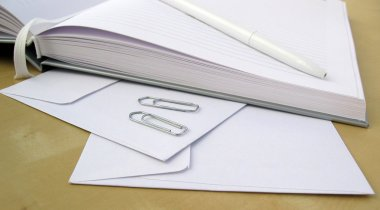 Business note book with pen and envelopes