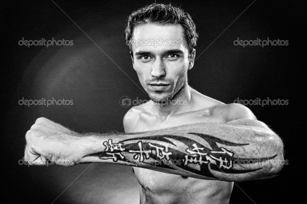 man showing hand with tattoo black and white focus on face stock photo roystudio 7621249. Black Bedroom Furniture Sets. Home Design Ideas