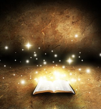 An open Bible with glowing lights and stars on an old textured background stock vector