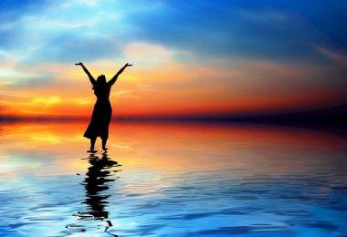 Woman Praising at the beach