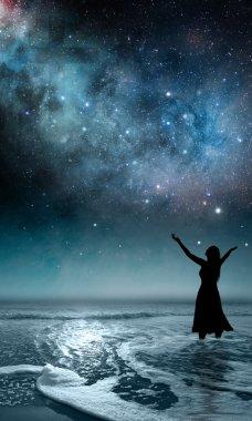 Woman Praising at the ocean