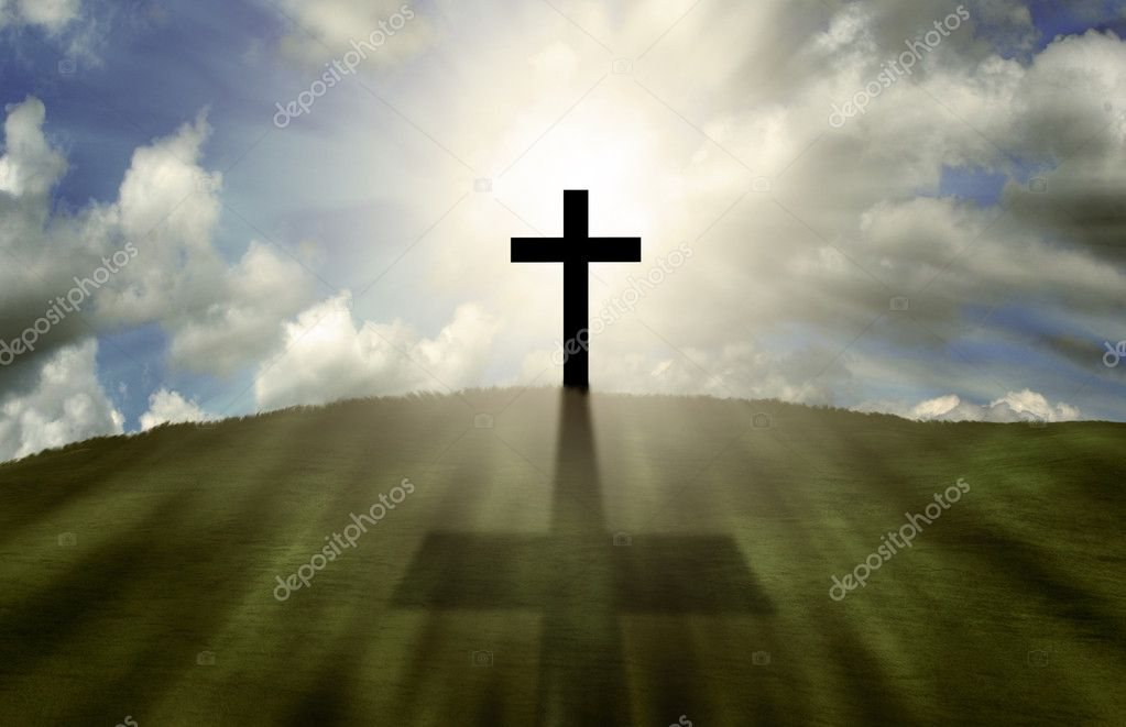 Cross glowing on a hill