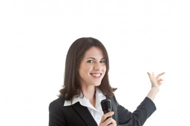Caucasian Woman Holding Microphone Pointing Behind White Backgro