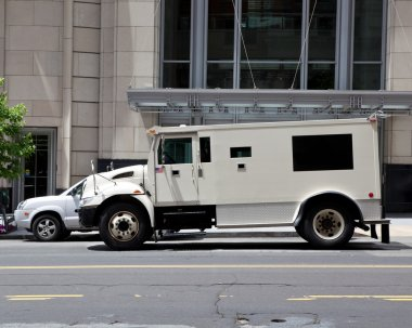 Side View Armoured Armored Car Parked on Street Outside Building