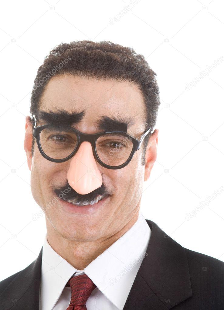 Smiling Businessman Wearing Groucho Marx Glasses Isolated On Whi