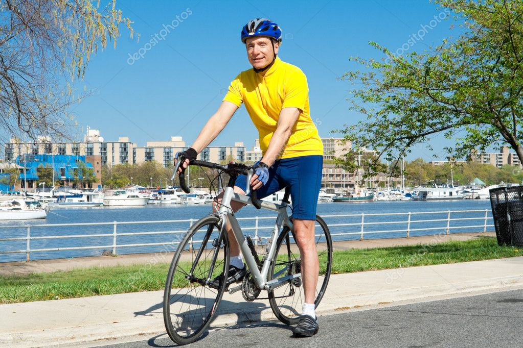 Senior Man With Helmet Sitting on a Bicycle