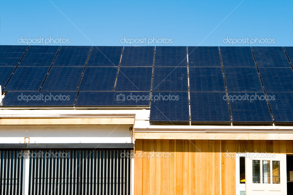 Modern House Photovoltaic PV Solar Panels Roof Sky