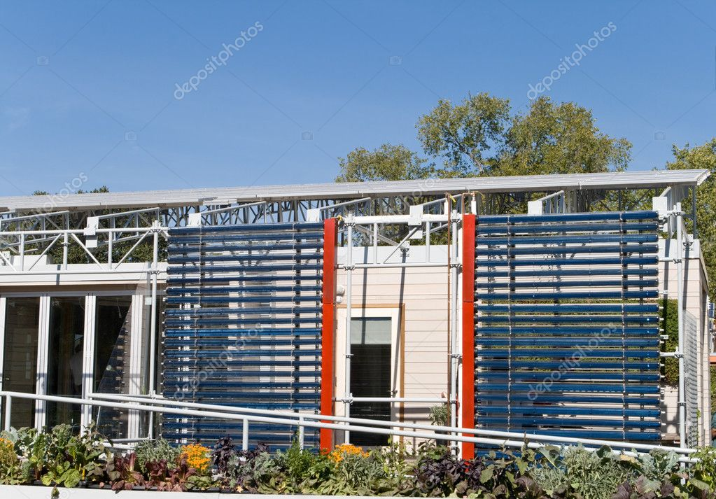 Two Racks Of Solar Water Heaters On The Side Of A Modern Home. Photovoltaic  Solar Panels On The Roof. U2014 Photo By Qingwa