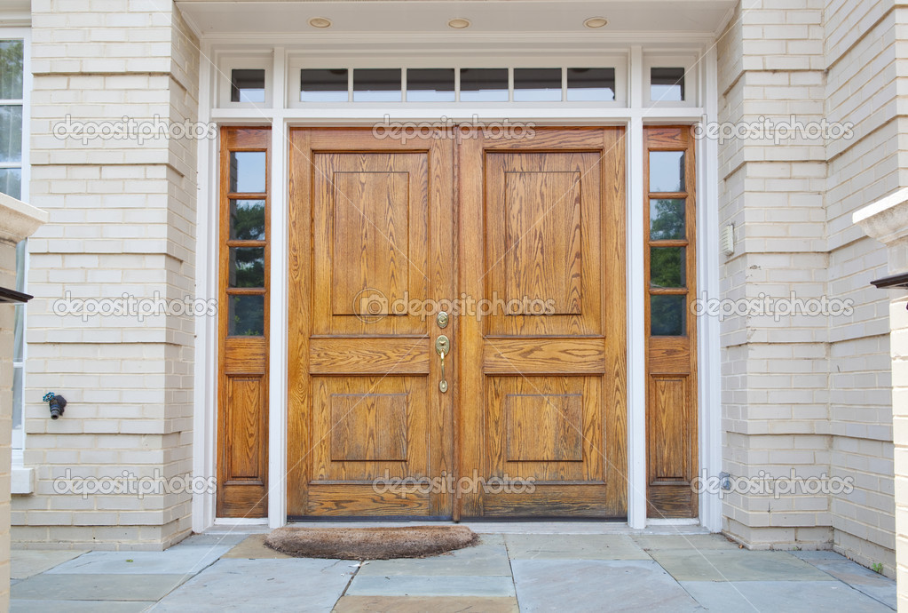 Xxxl wooden double door grand entrance to a home stock for Houses with double front doors