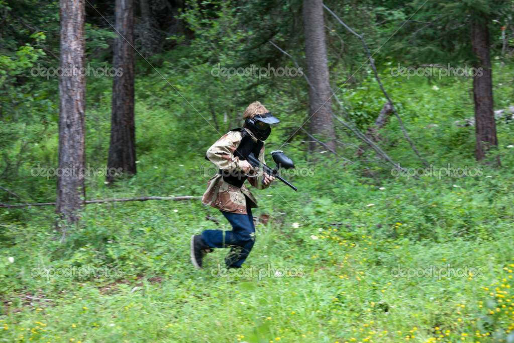 Playing Paintball in The Woods
