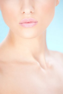 Cosmetic pencil near womans lips