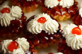 Small cupcakes with cream and cherry #1