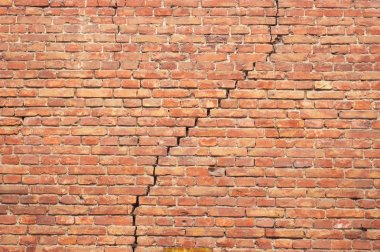 Cracked redbrick wall