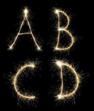 Christmas alphabet created a sparkler