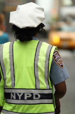 Policewoman directing traffic in the city