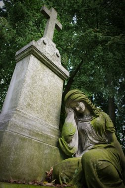 Old grave with woman statue