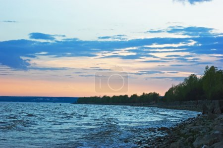 Sunset on rocky shore hdr