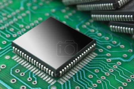 Photo for Pile of microchips on a printed circuit board - Royalty Free Image