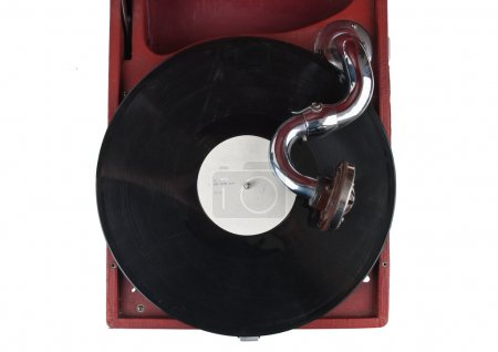Vintage ggramophone with a dusty old vinyl record