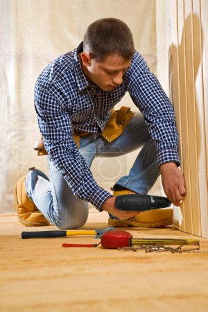Single man work in the wooden room