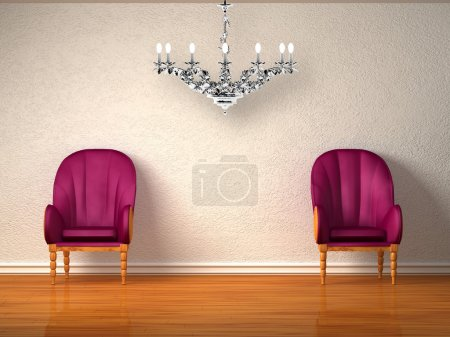 Two luxurious chairs with silver chandelier in min...